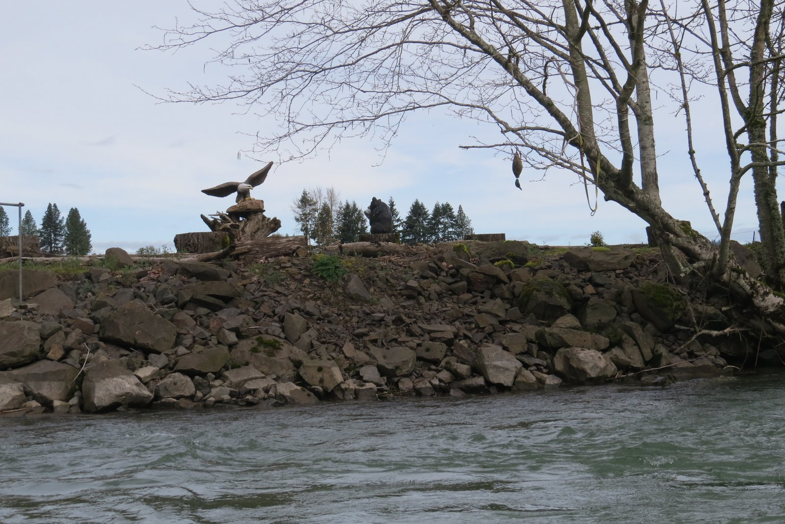 Eagle and Duck on river bank [statues]